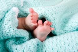 Hispanic baby feet